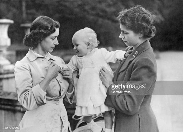 Queen Elizabeth II and her sister Princess Margaret and baby daughter Princess Anne in the grounds of Balmoral Castle in Scotland 21st August 1951
