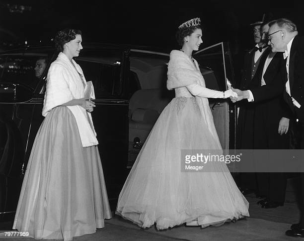 Queen Elizabeth II and her sister Princess Margaret arrive at the Empire cinema Leicester Square London for the Royal Command Film Performance 16th...