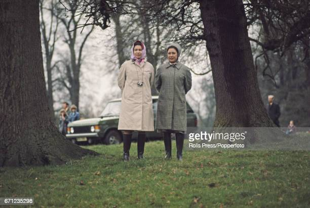 Queen Elizabeth II and her sister, Princess Margaret, Countess of Snowdon pictured together as they observe events at the Badminton horse trials in...