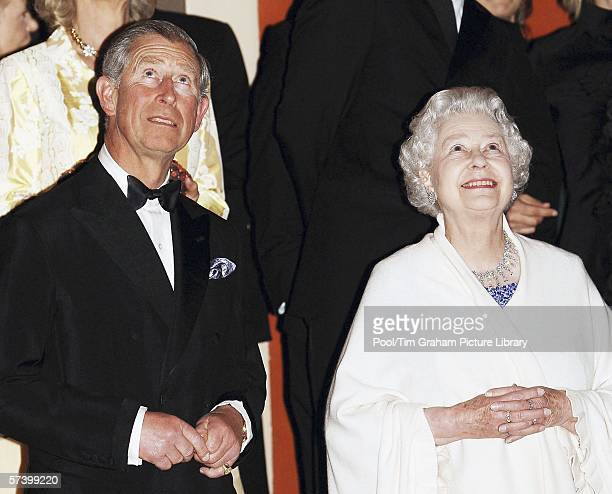 Queen Elizabeth II and her son Prince Charles the Prince of Wales watch a firework display at her 80th birthday dinner at Kew Palace on April 21,...