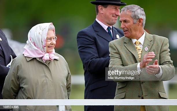 Queen Elizabeth II and her stud groom Terry Pendry watch her horse Barbers Shop win the Tattersalls Ror Thoroughbred Ridden Show Horse Class on day 3...