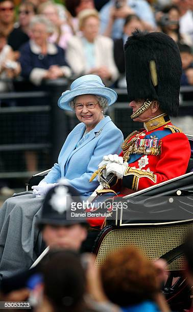 Queen Elizabeth II and HRH Prince Phillip, The Duke of Edinburgh return to Buckingham Palace after watching the trooping of The Queen's Colour of...