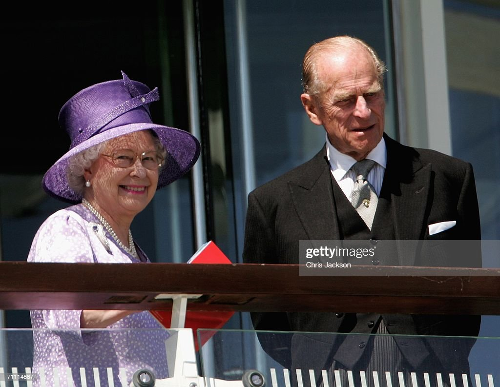 Queen Elizabeth II and HRH The Duke of Edinburgh watch from the Royal Balcony at the Vodafone Epsom Derby on June 3, 2006 in Epsom, England. The Derby is one of the biggest horse races of the year, with prize money totaling GBP1m