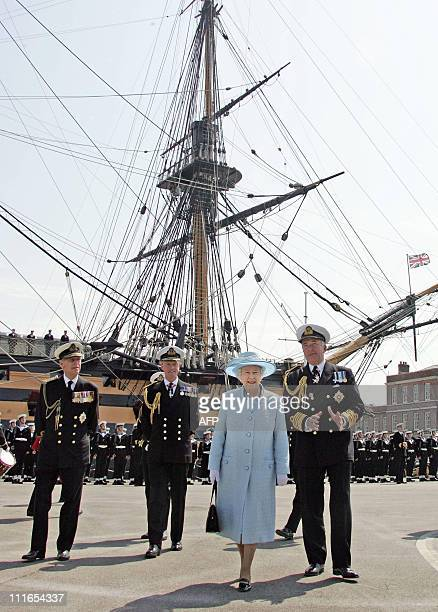 Queen Elizabeth II and HRH The Duke of Edinburgh with Admiral Sir Alan West review a Guard of Honour by HMS Victory 29 June 2005 for the celebration...
