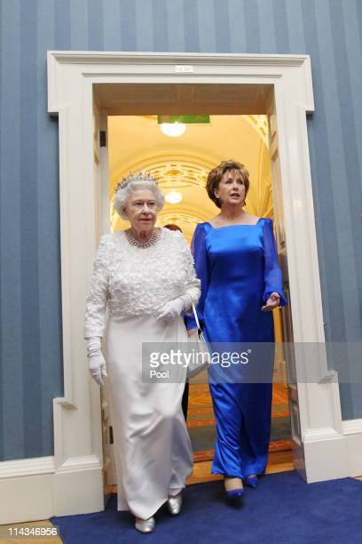 Queen Elizabeth II and Irish President Mary McAleese arrive for a State Dinner at Dublin Castle on May 18 2011 in Dublin Ireland The Duke and Queen's...
