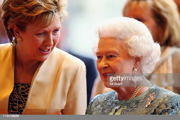 Queen Elizabeth II and Irish President Mary McAleese listen to live classical music as they arrive at the Convention Centre Dublin for an evening of...
