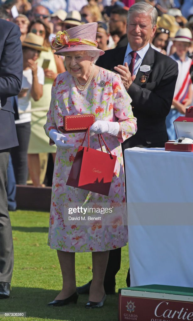 Queen Elizabeth II and Jock Green-Armytage attend the Cartier Queen's Cup Polo final at Guards Polo Club on June 18, 2017 in Egham, England.