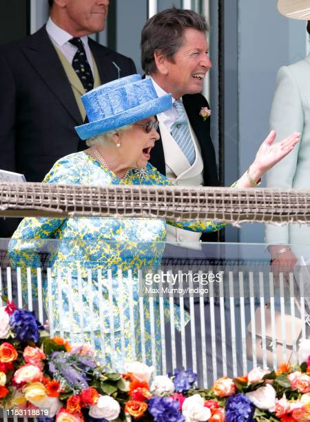 Queen Elizabeth II and John Warren watch the racing as they attend 'Derby Day' of the Investec Derby Festival at Epsom Racecourse on June 1, 2019 in...