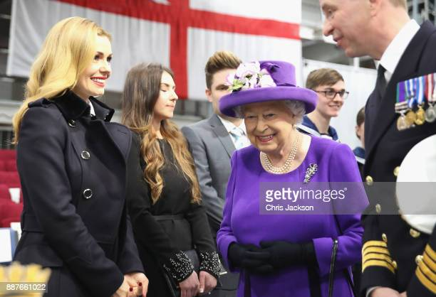 Queen Elizabeth II and Katherine Jenkins attend the Commissioning Ceremony of HMS Queen Elizabeth at HM Naval Base on December 7 2017 in Portsmouth...