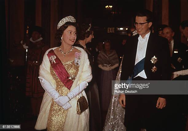 Queen Elizabeth II and King Baudouin of Belgium attend a performance at the Royal Opera House in Covent Garden. London, England, May 1963.