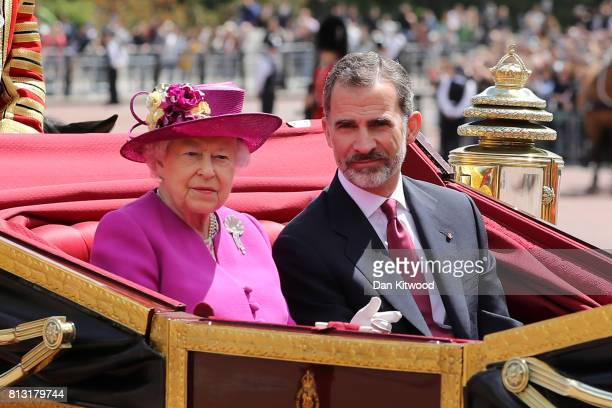 Queen Elizabeth II and King Felipe VI of Spain ride in a carriage during a State visit by the King and Queen of Spain at Centre Gate Buckingham...