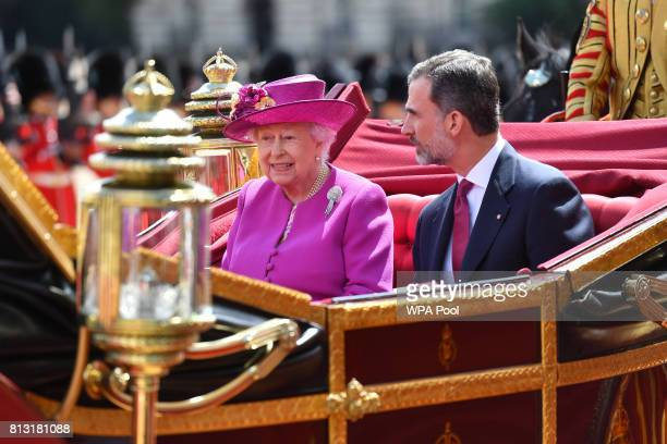 Queen Elizabeth II and King Felipe VI of Spain ride in a carriage during a State visit by the King and Queen of Spain on July 12 2017 in London...