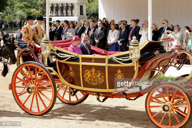 Queen Elizabeth II and King Felipe VI of Spain ride in a carriage to Buckingham Palace after a Ceremonial Welcome on Horse Guards Parade on July 12...