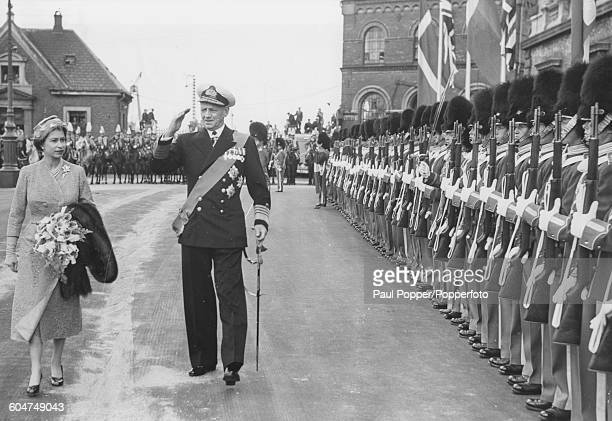 Queen Elizabeth II and King Frederik IX of Denmark inspect a Guard of Honour at the Custom House Quay in Copenhagen on the first day of a State Visit...