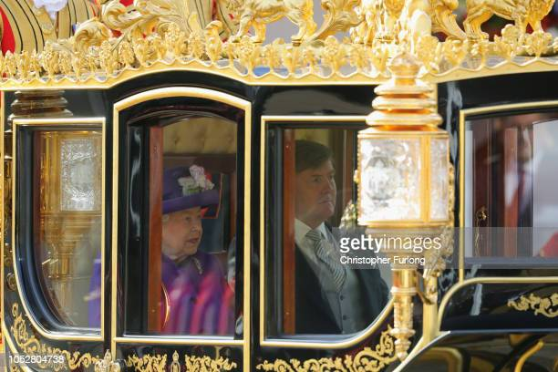 Queen Elizabeth II and King WillemAlexander of the Netherlands travel in a carriage during a ceremonial welcome at Horse Guards Parade on October 23...