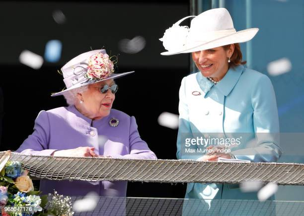Queen Elizabeth II and Lady Carolyn Warren attend Derby Day of the Investec Derby Festival at Epsom Racecourse on June 2 2018 in Epsom England
