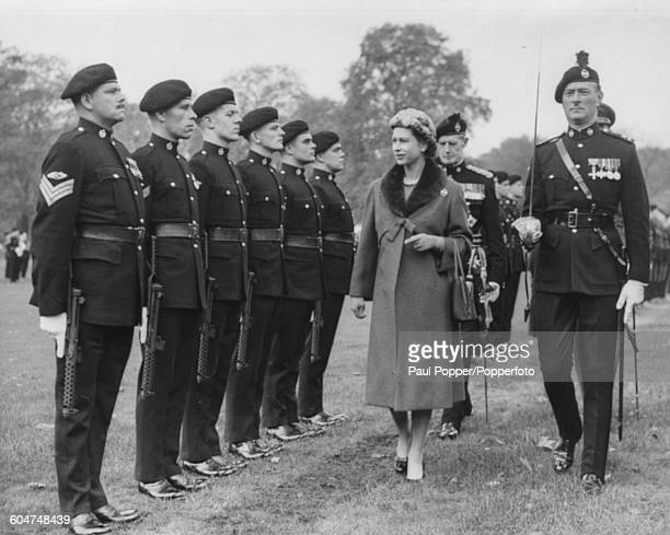 Queen Elizabeth II and Lieutenant Colonel Hugo Ironside OBE inspect the ranks of the royal Tank Regiment during the presentation of Standards in the...