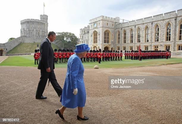 Queen Elizabeth II and Lieutenant Colonel Sir Andrew Ford walk out to await the arrival of the President of the United States Donald Trump and First...