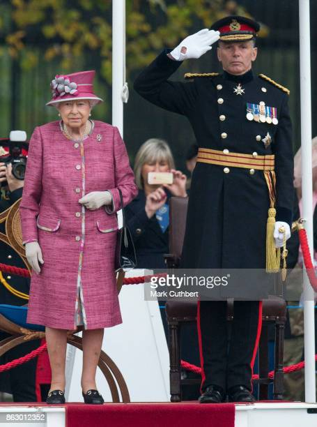 Queen Elizabeth II and Lieutenant General Andrew Gregory review The King's Troop Royal Horse Artillery on the 70th anniversary at Hyde Park on...