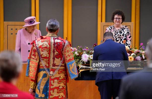 Queen Elizabeth II and Llywydd Elin Jones arrive inside the Siambr during the ceremonial opening of the Sixth Senedd at The Senedd on October 14,...