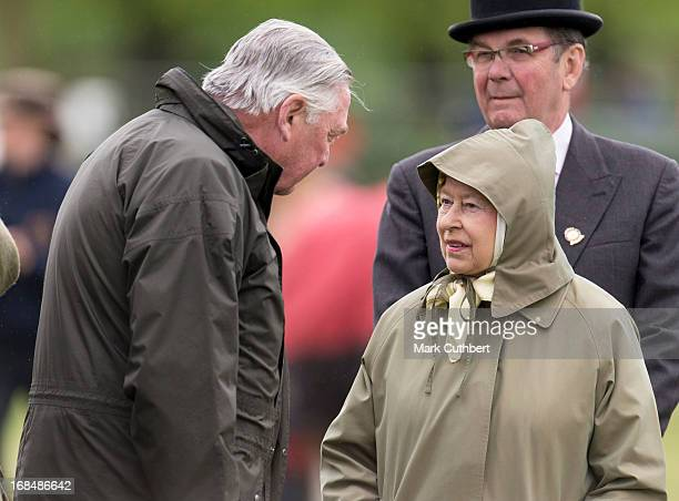 Queen Elizabeth II and Lord Vestey at The Royal Windsor Horse Show on May 10, 2013 in Windsor, England.