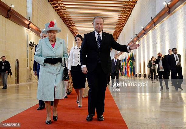 Queen Elizabeth II and Malta's Prime Minister Joseph Muscat arrive for the opening ceremony of the Commonwealth Heads of Government Meeting at the...