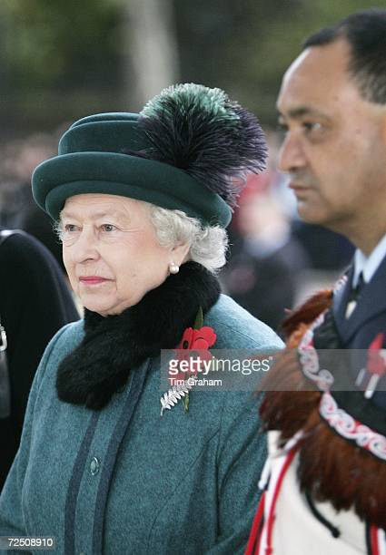 Queen Elizabeth II and Maori Warrant Officer Wal Wallace attend the official dedication of the New Zealand Memorial at Hyde Park Corner on November...
