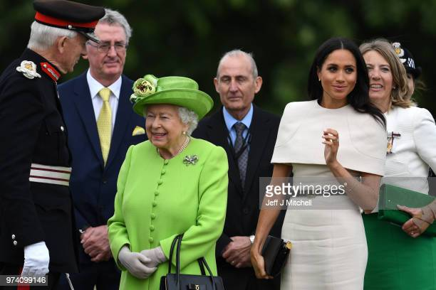 Queen Elizabeth II and Meghan Duchess of Sussex arrive to open the new Mersey Gateway Bridge on June 14 2018 in the town of Widnes in Halton Cheshire...