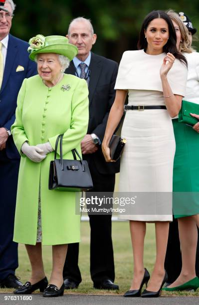 Queen Elizabeth II and Meghan Duchess of Sussex attend a ceremony to open the new Mersey Gateway Bridge on June 14 2018 in Widnes England Meghan...