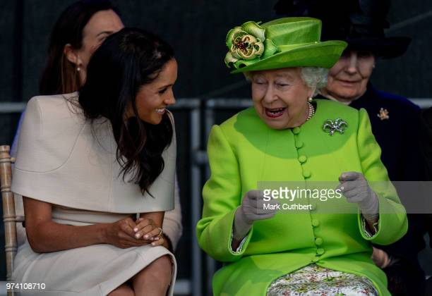 Queen Elizabeth II and Meghan Duchess of Sussex during a visit to the Catalyst Museum by the Mersey Gateway Bridge on June 14 2018 in Widnes England...