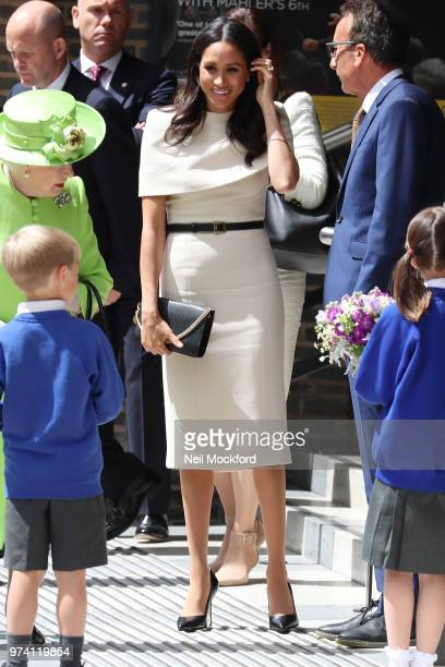 Queen Elizabeth II and Meghan Duchess of Sussex leave the Storyhouse Chester on June 14 2018 in Chester England Meghan Markle married Prince Harry...