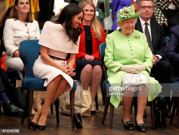 Queen Elizabeth II and Meghan Duchess of Sussex visit the Storyhouse to Chester Town Hall on June 14 2018 in Chester England Meghan Markle married...