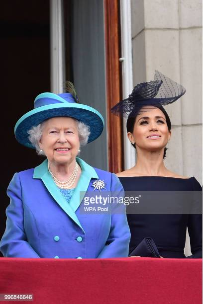 Queen Elizabeth II and Meghan, Duchess of Sussex watch the RAF 100th anniversary flypast from the balcony of Buckingham Palace on July 10, 2018 in...