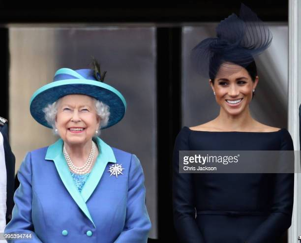Queen Elizabeth II and Meghan Duchess of Sussex watch the RAF flypast on the balcony of Buckingham Palace as members of the Royal Family attend...