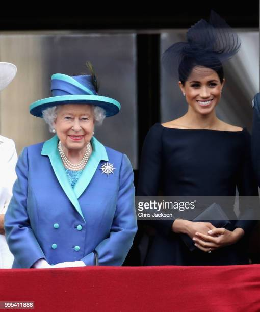 Queen Elizabeth II and Meghan, Duchess of Sussex watch the RAF flypast on the balcony of Buckingham Palace, as members of the Royal Family attend...
