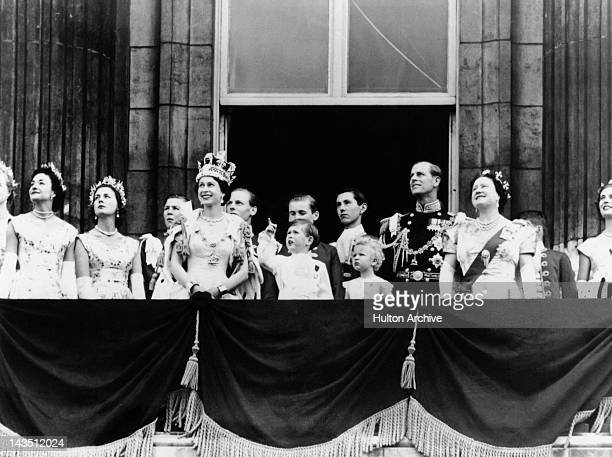 Queen Elizabeth II and members of the royal family watching an RAF flypast from the balcony of Buckingham Palace during the Queen's Coronation...