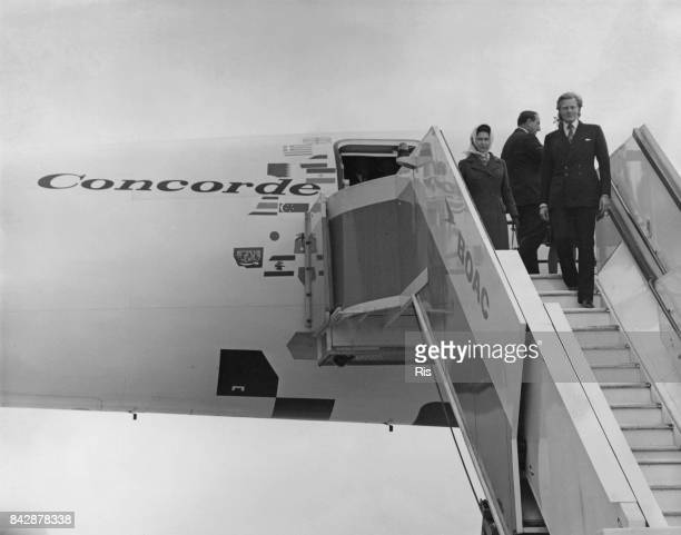 Queen Elizabeth II and Michael Heseltine, the Minister for Aerospace, inspect the supersonic jet airliner Concorde after its sales tour flight to 11...
