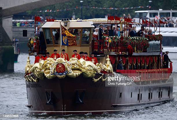 Queen Elizabeth II and other members of the Royal family sail on the royal barge 'The Spirit of Chartwell' during the Thames Diamond Jubilee River...