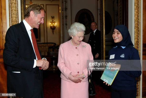 Queen Elizabeth II and Poet Laureate Andrew Motion present Zainab Ahmed right with a book selected by the laureate From Here to Eternity An Anthology...