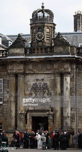 Queen Elizabeth II and Pope Benedict XVI leave the Palace of Holyroodhouse the Queen's official residence in Scotland on September 16 2010 in...