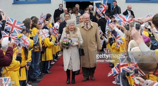 Queen Elizabeth II and President Ivan Gasparovic leave the ice hockey stadium on the second day of a tour of Slovakia on October 24, 2008 in...