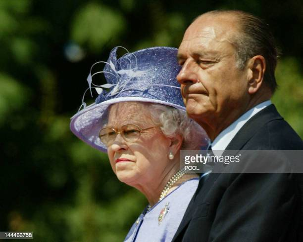 Queen Elizabeth II and President Jacques Chirac of France watch the DDay commeration ceremonies at the Commonwealth War Graves Cemetery in Bayeux...