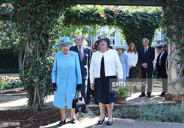 Queen Elizabeth II and President of Malta MarieLouise Coleiro Preca walk in the gardens of San Anton Palace on November 28 2015 in Valletta Malta