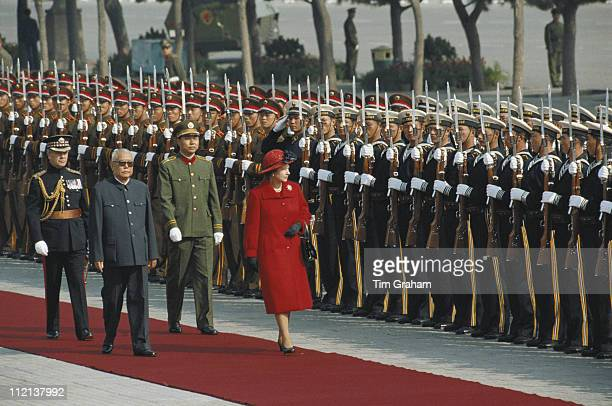 Queen Elizabeth II and President of the People's Republic of China Li Xiannian inspect a guard of honour in in Tiananmen Square in Beijing China 13...
