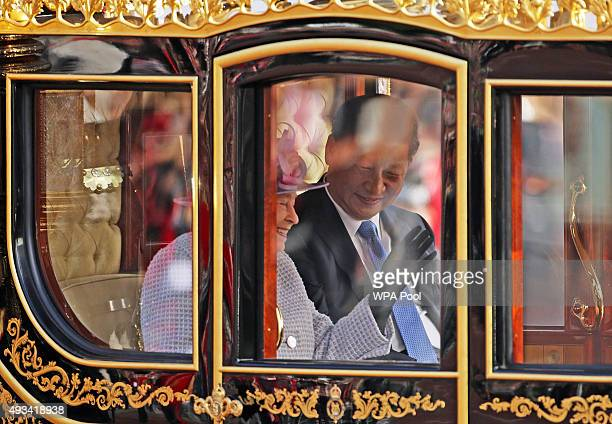 Queen Elizabeth II and President of The People's Republic of China, Xi Jinping, ride in the Diamond Jubilee State Coach along The Mall after the...