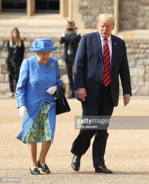 Queen Elizabeth II and President of the United States Donald Trump inspect a n honour guard at Windsor Castle on July 13 2018 in Windsor England Her...