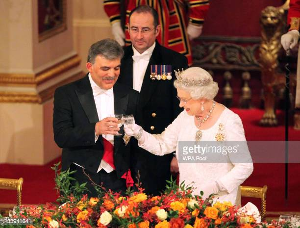 Queen Elizabeth II and President of Turkey Abdullah Gul attend a state banquet at Buckingham Palace on November 22 2011 in London England President...