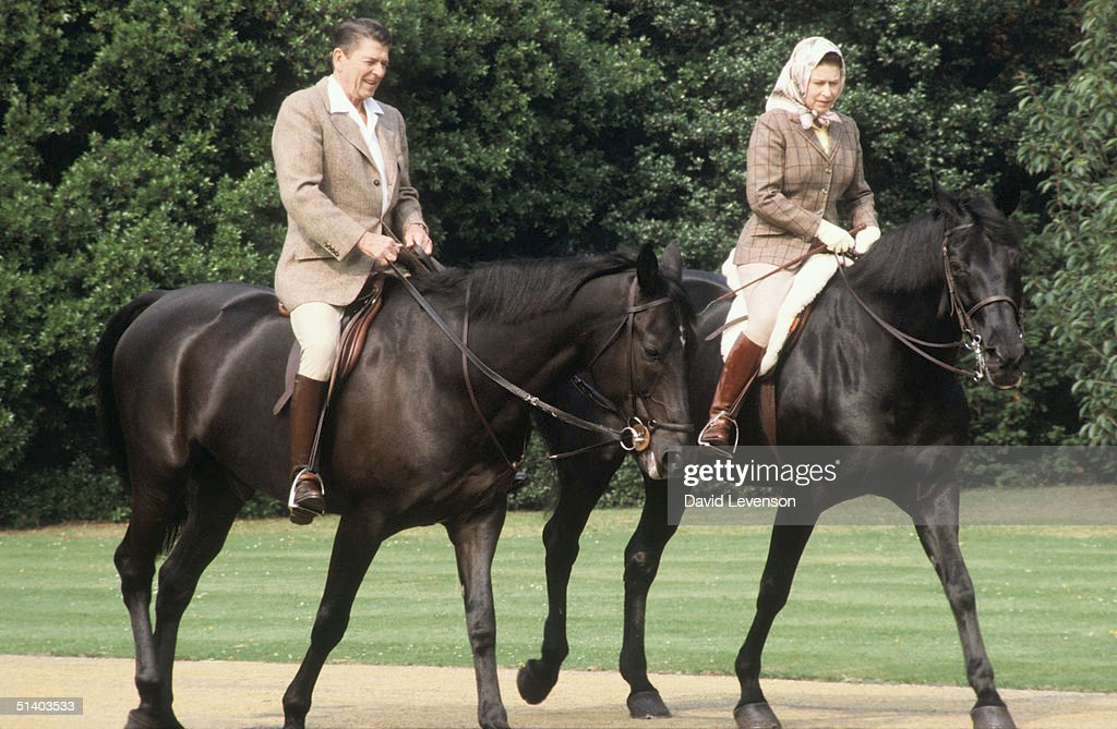 Queen Elizabeth II and President Ronald Reagan riding through the grounds of Windsor Castle : News Photo