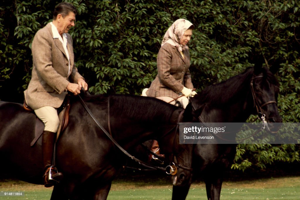 Queen Elizabeth II and President Ronald Reagan riding through the grounds of Windsor Castle... : News Photo