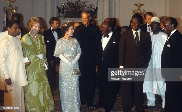 Queen Elizabeth II and Prime Minister Margaret Thatcher attend a ball to celebrate the Commonwealth Heads of Government Conference hosted by...